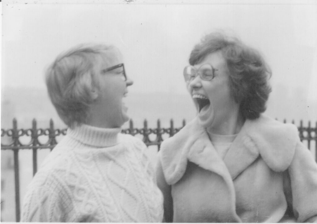 Black and white image of two women laughing